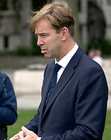 Tobias Ellwood MP At the  photocall the  took place in Parliament Square to mark Nazanin Zaghari-Ratcliffe's 2000th day of being detained in Iran, A giant snakes and ladders board was used to show the ups and downs of Nazanin's case photo by Leigh Bruin