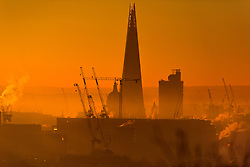 © Licensed to London News Pictures. 29/12/2016. London, UK. The Shard and St Paul's Cathedral seen at sunrise over the city of London, as seen from Parliament Hill on Hampstead Heath, Hampstead, North London on another cold winter morning. Most of the UK has woken to freezing temperatures. Photo credit: Ben Cawthra/LNP