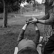 A fitness trainer works with a client in a West Hills park on Easter Sunday when all city parks were closed to prevent any gatherings. All gyms and fitness centers were closed as non-essential businesses forcing trainers and their clients to find alternatives.