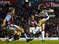 Photo: Chris Ratcliffe.<br />Tottenham Hotspur v Aston Villa. The Barclays Premiership. 21/01/2006.<br />Grzegorz Rasiak (R) of Spurs takes a shot as Olof Melberg of Villa closes him down.
