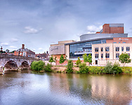 Photo Art Print of Theatre Severn and the Welsh Bridge over the river Severn in Shrewsbury available as a Download, Framed, Canvas, Fine Art and Photo Print. The Theatre Severn is the newest public building the small market town of Shrewsbury in Shropshire. Shrewsbury is my home town and it has been great to see this new building spring up in the heart of the town. The really clever thing about this building is the way it used modern materials and building methods and yet remained sympathetic to the older buildings which surround it.