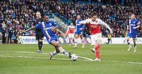 Fleetwood Town's Josh Morris sees his shot blocked by Gillingham's Amari'i Bell<br /> <br /> Photographer Stephen White/CameraSport<br /> <br /> Football - The Football League Sky Bet League One - Gillingham v Fleetwood Town -  Friday 3rd April 2015 - MEMS Priestfield Stadium - Gillingham<br /> <br /> © CameraSport - 43 Linden Ave. Countesthorpe. Leicester. England. LE8 5PG - Tel: +44 (0) 116 277 4147 - admin@camerasport.com - www.camerasport.com