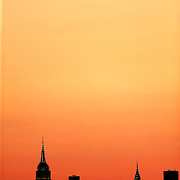 2017 U.S. Open Tennis Tournament - DAY ELEVEN. The Manhattan skyline at sunset showing the Empire State Building, (highest point, left) and the Chrysler building shot from the Arthur Ashe Tennis Stadium, Queens New York, during the US Open Tennis Tournament at the USTA Billie Jean King National Tennis Center on September 07, 2017 in Flushing, Queens, New York City.  (Photo by Tim Clayton/Corbis via Getty Images)