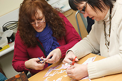 People doing a craft activity at a resource for people with physical and sensory impairment.