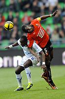 FOOTBALL - FRENCH CHAMPIONSHIP 2010/2011 - L1 - STADE RENNAIS v AJ AUXERRE - 2/04/2011 - PHOTO PASCAL ALLEE / DPPI - DENNIS OLIECH (AJA)  / KADER MANGANE (REN)