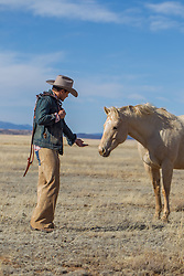 cowboy with a friendly horse on a ranch