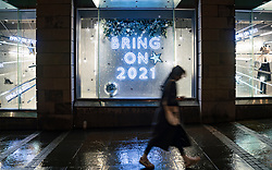 Edinburgh, Scotland, UK. 19 December 2020.  Views of streets and shops in Edinburgh City Centre on evening that Scottish Government announced the highest level 4 lockdown will be enforced from Boxing Day in Scotland.  Pic; shop window display with downbeat Christmas message in Harvey Nichols store. Iain Masterton/Alamy Live News