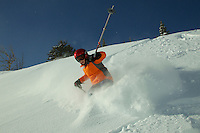Russell Laman (age 12) skiing fresh powder snow in Jackson Hole, Wyoming