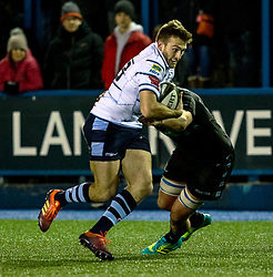Garyn Smith of Cardiff Blues evades the tackle of Adam Ashe of Glasgow Warriors<br /> <br /> Photographer Simon King/Replay Images<br /> <br /> Guinness PRO14 Round 15 - Cardiff Blues v Glasgow Warriors - Saturday 16th February 2019 - Cardiff Arms Park - Cardiff<br /> <br /> World Copyright © Replay Images . All rights reserved. info@replayimages.co.uk - http://replayimages.co.uk