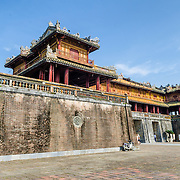 The Citadel Gate at the Imperial City in Hue, Vietnam. A self-enclosed and fortified palace, the complex includes the Purple Forbidden City, which was the inner sanctum of the imperial household, as well as temples, courtyards, gardens, and other buildings. Much of the Imperial City was damaged or destroyed during the Vietnam War. It is now designated as a UNESCO World Heritage site.