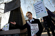 People's Vote supporter dressed as a Suffragette gives a rousing speech beside the statue of Millicent Fawcett ahead of a crunch debate in the House of Commons to illustrate that this Brexit would provide no clarity and no closure about our future relationship with Europe on 14th February 2019 in London, England, United Kingdom.