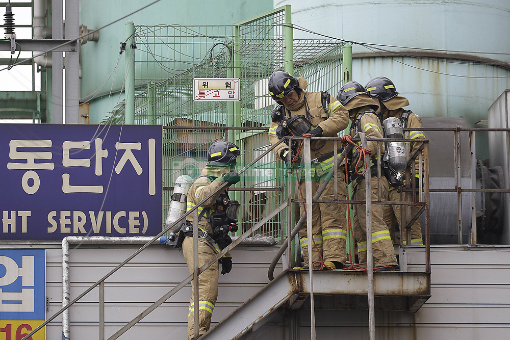 April 13, 2018 - Incheon, SOUTH KOREA - April 13, 2018-Incheon, South Korea-A chemical processing plant west of Seoul has caught fire, blanketing the area with thick, dark smoke and potentially leaking toxic substances, firefighters said Friday. No casualties have been reported. The blaze started at around 11:50 a.m. in a chemical recyling factory in Incheon. A witness made the call to the emergency services saying ''pillars of dark smoke are surging'' from the plant.  No reports of casualties from the factory have been made, authorities said. One fireman suffered an injury to his ankle and a fire truck has been gutted by fire after it caught flame.  Fire authorities have mobilized all available forces, including 430 firefighters and 80 vehicles, in the area and are working to put out the blaze. They also issued a third-phase warning, the highest level of alert. But the thick and toxic fumes are hindering them making their way into the factory, the authorities said. The authorities have evacuated about 300 workers from nearby buildings. The firefighters said they are figuring out how many people were inside the factory before the fire broke out. The industrial complex to which the factory belongs houses nine companies, mostly dealing with oil waste processing. (Credit Image: © Ryu Seung-Il via ZUMA Wire)