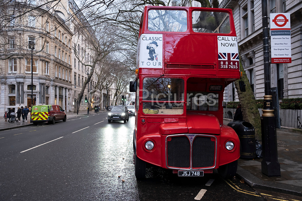 Classic Tours Routemaster red bus on 19th December 2020 in London, United Kingdom. The AEC Routemaster is a double-decker bus designed by London Transport and built by the Associated Equipment Company AEC and Park Royal Vehicles. The first prototype was completed in September 1954 and the last one was delivered in 1968.