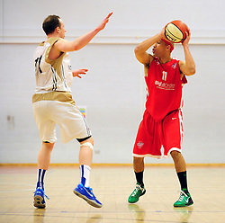 Bristol Academy Flyers' Greg Streete looks for options whilst being closed down by Essex Leopards' Jamelle Davis - Photo mandatory by-line: Dougie Allward/JMP - Tel: Mobile: 07966 386802 23/03/2013 - SPORT - Basketball - WISE Basketball Arena - SGS College - Bristol -  Bristol Academy Flyers V Essex Leopards
