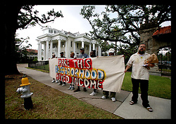 17 June, 2006. New Orleans, Louisiana. Housing problems. Protesters, former public housing residents and supporters march along St Charles Ave to the private gated community of Audubon Place to protest The Housing Authority of New Orleans (HANO) plan to demolish public housing, refusing residents the right to return despite valid leases. The housing authority proposes to replace crime riddled, poorer projects with a mix of private and public housing created by private contractors. Former residents argue that HANO is part of a greater city plot to keep poor, predominantly African Americans from returning home.