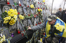 November 21, 2018 - Kiev, Ukraine - A man lays flowers at the memorial to victims of Maidan anti-government protests,during the fifth anniversary of the Euromaidan Revolution beginning in Kiev, Ukraine. On 21 November 2013 activists started an anti-government protest after then-Prime Minister Mykola Azarov announced the suspension of a landmark treaty with the European Union. Ukraine mark anniversary of Euromaidan protests beginning which rocked the capital Kiev five years ago and lead to a change in Ukrainian government. (Credit Image: © Str/NurPhoto via ZUMA Press)