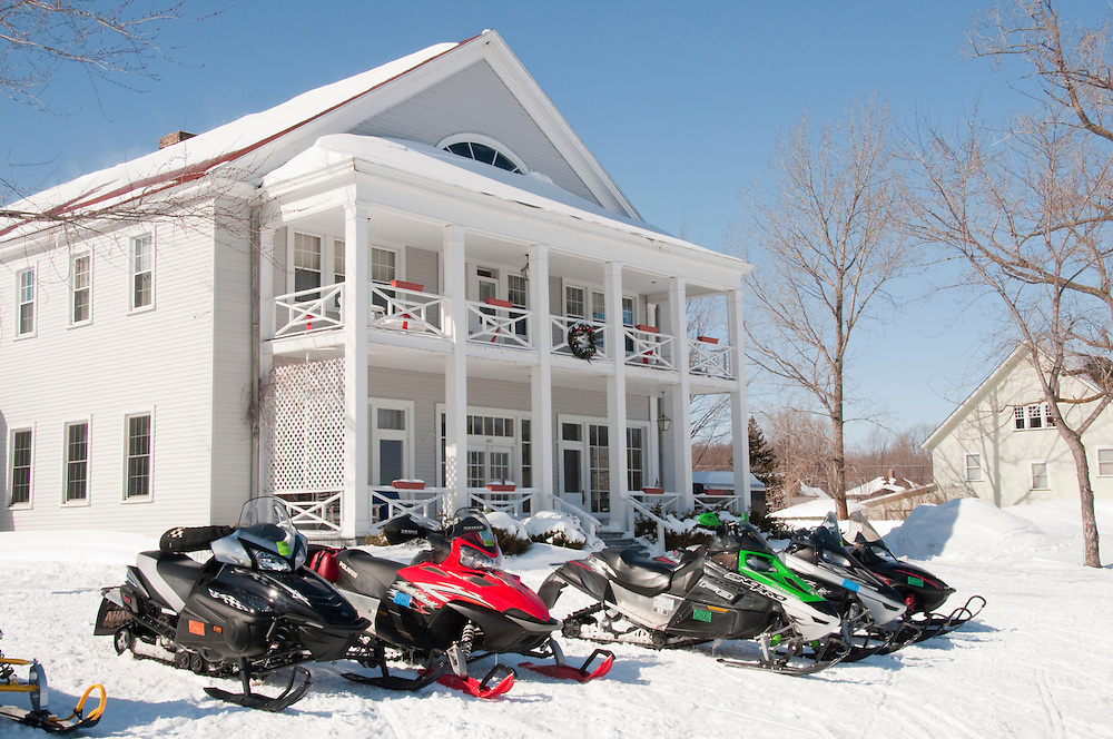The Thunder Bay Inn in Big Bay Michigan with snowmobiles in winter.
