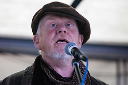 London, UK. 1st December, 2018. Paul Allen of the Centre for Alternative Technology, responsible for the Zero Carbon Britain project, addresses the Together for Climate Justice demonstration against Government policies in relation to climate change, including Heathrow expansion and fracking. Following a rally outside the Polish embassy, chosen to highlight the UN's Katowice Climate Change Conference which begins tomorrow, protesters marched to Downing Street.