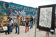 Visitors check out some of the art available in various booths at the Deep Ellum Arts Festival in Dallas on Sunday, April 7, 2013. (Cooper Neill/The Dallas Morning News)