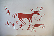 Recontructed fresco of an original found at Catalhoyuk. The men are hunting a deer and pulling on its tounge to disable it. The hunters are believed by scholors to be wearing leopard skin costumes, Painted by Mutlu Gundiler. Reconstructed houses, Catalyhoyuk Archaeological Site, Çumra, Konya, Turkey .<br /> <br /> If you prefer to buy from our ALAMY PHOTO LIBRARY  Collection visit : https://www.alamy.com/portfolio/paul-williams-funkystock/catalhoyuk-site-turkey.html<br /> <br /> Visit our TURKEY PHOTO COLLECTIONS for more photos to download or buy as wall art prints https://funkystock.photoshelter.com/gallery-collection/3f-Pictures-of-Turkey-Turkey-Photos-Images-Fotos/C0000U.hJWkZxAbg