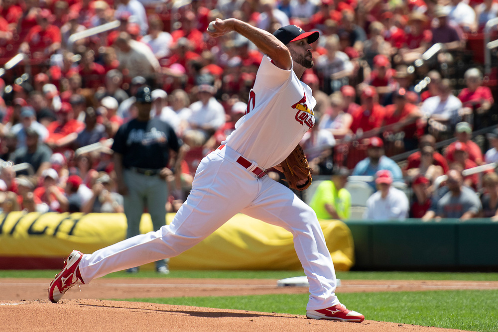 Saint Louis Cardinals pitcher Adam Wainwright pitches from the stretch in a baseball game between the Atlanta Braves and Saint Louis Cardinals August 7 2016 at Busch Stadium in Saint Louis, Mo