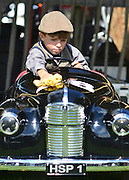 © Licensed to London News Pictures. 14/09/2012. Goodwood, UK Harry Pierly aged 7 cleans his vintage toy J40 pedal car. People enjoy the atmosphere at the 2012 Goodwood Revival Meeting today 14 September 2012. Participants are encouraged to dress in period dress.. Photo credit : Stephen Simpson/LNP