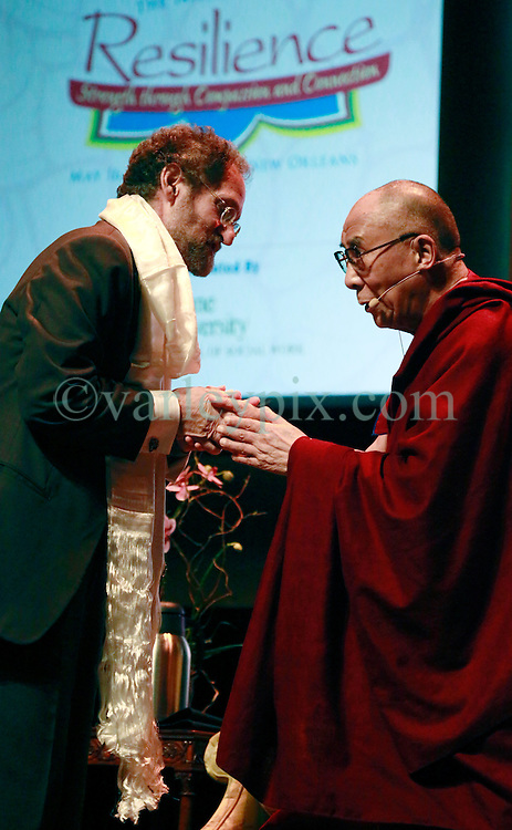 17 May 2013. New Orleans, Louisiana,  USA..His Holiness the 14th Dalai Lama gives a Kata, a Tibetan cloth to Dr Ronald Marks, Dean of Tulane University School of Social Science at the Morial Convention Center . The Dalai Lama is in New Orleans for the 'Resiliance - Strength through Compassion and Connection' conference. .Photo; Charlie Varley.