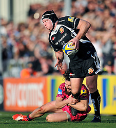 Thomas Waldrom of Exeter Chiefs is tackled by Seb Stegmann of London Welsh - Photo mandatory by-line: Patrick Khachfe/JMP - Mobile: 07966 386802 07/03/2015 - SPORT - RUGBY UNION - Exeter - Sandy Park - Exeter Chiefs v London Welsh - Aviva Premiership