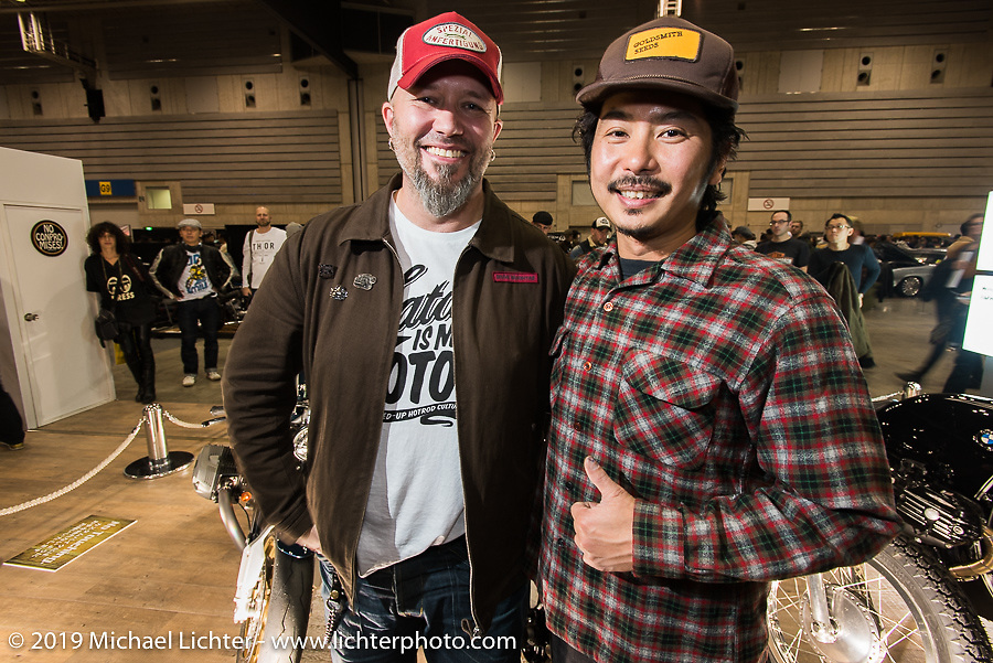 Brat Style's Go Takamine with BMW's head of motorcycle design Ola Stenegard at the unveiling of custom BMW's during the Annual Mooneyes Yokohama Hot Rod and Custom Show. Japan. Sunday, December 7, 2014. Photograph ©2014 Michael Lichter.