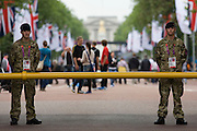 Soldiers of the British army stand guarding the entrance to  the volleyball venue in central London next to the IOC rings logo on day 4 of the London 2012 Olympic Games. A total of 18,000 defence personel were called upon to make the Games secure following the failure by security contractor G4S to provide enough private guards. The extra personnel have been drafted in amid continuing fears that the private security contractor's handling of the £284m contract remains a risk to the Games.