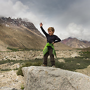 A boy screams out to his brother in the Karakoram mountains.