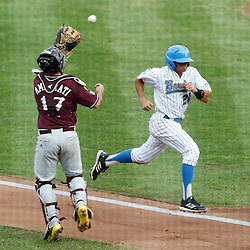Jun 25, 2013; Omaha, NE, USA; UCLA Bruins center fielder Brian Carroll (24) scores against Mississippi State Bulldogs catcher Nick Ammirati (17) during the first inning in game 2 of the College World Series finals at TD Ameritrade Park. Mandatory Credit: Derick E. Hingle-USA TODAY Sports