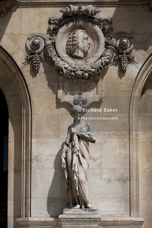 German composer Johann Sebastian Bach (1685 – 1750)  on the exterior of the Opera Garnier Paris, France. The Palais Garnier is a 1,979-seat opera house, which was built from 1861 to 1875 for the Paris Opera.