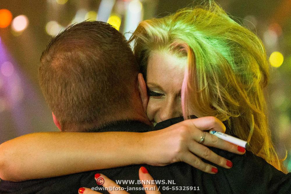 NLD/Amsterdam//20140331 - Uitreiking Edison Pop 2014, Miss Montreal omhelst Jannes
