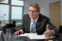 03 JAN 2008, BERLIN/GERMANY:<br /> Ronald Pofalla, CDU Generalsekretaer, waehrend einem Interview, in seinem Buero, Konrad-Adenauer-Haus<br /> IMAGE: 20080103-01-013