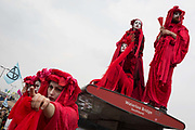 Theatrical Climate Change activists with Extinction Rebellion campaign for a better future for planet Earth after blocking Waterloo Bridge and as part of a multi-location 5-day Easter protest around the capital, on 16th April 2019, in London, England.