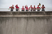 Brass band in red uniforms take a bow after their performance on top of Waterloo Bridge. The South Bank is a significant arts and entertainment district, and home to an endless list of activities for Londoners, visitors and tourists alike.