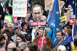 © Licensed to London News Pictures . 03/06/2019. Manchester, UK.  I LOVE BREXIT Vladimir Putin placard . A Manchester Together Against Trump demonstration in Cathedral Gardens , central Manchester , during the first day of US President Donald Trump's visit to the UK . Photo credit: Joel Goodman/LNP