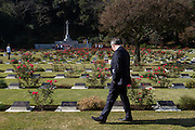 Canadian Ambassador,Ian Burney looks at graves during the ceremony for Remembrance Sunday at the Commonwealth War Graves Cemetery in Hodogaya, Yokohama, Japan. Sunday November 13th 2016. Each year representatives of the Commonwealth nations, along with American and other European nations that lost servicemen fighting the Japanese in World War 2, hold a multi-faith service of remembrance at this cemetery. This is the only cemetery for war dead in japan that is managed by the Commonwealth War Graves Commission.