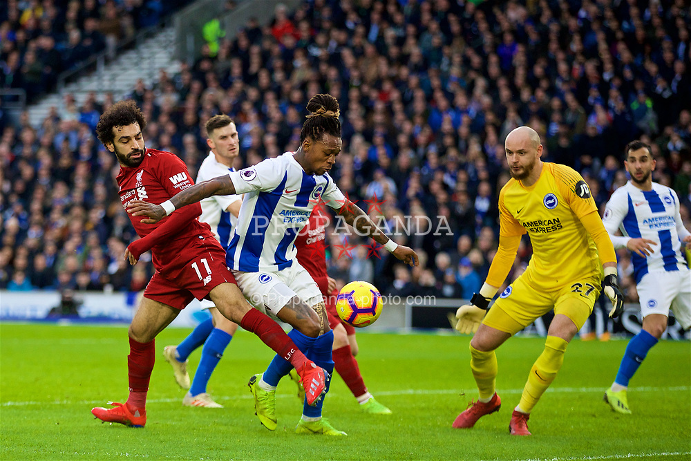 BRIGHTON AND HOVE, ENGLAND - Saturday, January 12, 2019: Liverpool's Mohamed Salah (L) and Brighton & Hove Albion's Gaëtan Bong during the FA Premier League match between Brighton & Hove Albion FC and Liverpool FC at the American Express Community Stadium. (Pic by David Rawcliffe/Propaganda)