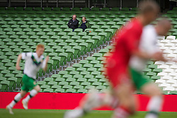 DUBLIN, REPUBLIC OF IRELAND - Friday, May 27, 2011: Two lonely supporters watch Northern Ireland take on Wales in a near-empty stadium during the Carling Nations Cup match at the Aviva Stadium (Lansdowne Road). (Photo by David Rawcliffe/Propaganda)