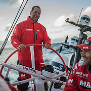 Leg 3, Cape Town to Melbourne, day 03, Blair Tuke, Pablo Arrarte, Sophie Ciszek  and Xabi Fernandez have a laugh discussing cold weather gear for the next few days and who Brought what on board MAPFRE. Photo by Jen Edney/Volvo Ocean Race. 12 December, 2017.
