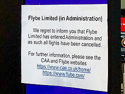 © Licensed to London News Pictures. 05/03/2020. London, UK. A flybe sign with an announcement taped to it advising that the company has entered administration at London's Heathrow airport. Airline 'flybe' has collapsed after financial difficulties exacerbated by a drop in business due to the COVID-19 coronavirus outbreak. Photo credit: Peter Manning/LNP