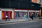 Shop shutters in Aldgate, London are painted with the letters forming the word HAPPY. This kind of inspirational street art is commonplace around the outskirts of the city.