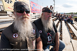 Dick Slider Gilmore (L) with his brother Charlie Chopper Gilmore at the drag racing finals at the Stugis Dragway during the Annual Sturgis Black Hills Motorcycle Rally. Sturgis, SD, USA. Monday August 7, 2017. Photography ©2017 Michael Lichter.