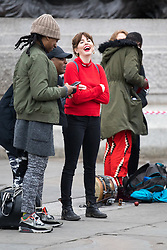 © Licensed to London News Pictures. 10/03/2018. London, UK. OPHELIA LOVIBOND (centre, in red) takes part in the 'Million Women Rise' march through central London, campaigning against domestic violence against women. Organisers have asked participants to wear red for the demonstration. On Thursday (8 March) this week, International Women's Day was celebrated. Photo credit : Tom Nicholson/LNP