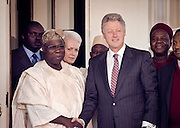 US President Bill Clinton meets with President Olesegun Obasanjo of Nigeria March 30, 1999 at the White House in Washington D.C.