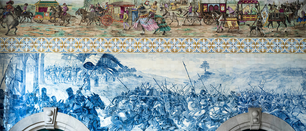 Detail of famous azulejos traditional Portuguese blue and white wall tiles Sao Bento railway station in Porto, Portugal