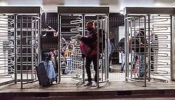 October 24, 2016 - Calais, France - A migrant leaves the official part of the Calais Jungle via a revolving door. The refugee camp on the coast to the English Channel is to be cleared today. The approximately 8,000 refugees are distributed after the registration by busses to various reception centers in France. (Credit Image: © Markus Heine/NurPhoto via ZUMA Press)