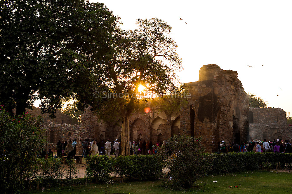 """11th December 2014, New Delhi, India. Believers pray, make offerings and ask for wishes to be granted by Djinns in the ruins of Feroz Shah Kotla in New Delhi, India on the 11th December 2014<br /> <br /> PHOTOGRAPH BY AND COPYRIGHT OF SIMON DE TREY-WHITE a photographer in delhi<br /> + 91 98103 99809. Email: simon@simondetreywhite.com<br /> <br /> People have been coming to Firoz Shah Kotla to leave written notes and offerings for Djinns in the hopes of getting wishes granted since the late 1970's. Jinn, jann or djinn are supernatural creatures in Islamic mythology as well as pre-Islamic Arabian mythology. They are mentioned frequently in the Quran  and other Islamic texts and inhabit an unseen world called Djinnestan. In Islamic theology jinn are said to be creatures with free will, made from smokeless fire by Allah as humans were made of clay, among other things. According to the Quran, jinn have free will, and Iblis abused this freedom in front of Allah by refusing to bow to Adam when Allah ordered angels and jinn to do so. For disobeying Allah, Iblis was expelled from Paradise and called """"Shaytan"""" (Satan).They are usually invisible to humans, but humans do appear clearly to jinn, as they can possess them. Like humans, jinn will also be judged on the Day of Judgment and will be sent to Paradise or Hell according to their deeds. Feroz Shah Tughlaq (r. 1351–88), the Sultan of Delhi, established the fortified city of Ferozabad in 1354, as the new capital of the Delhi Sultanate, and included in it the site of the present Feroz Shah Kotla. Kotla literally means fortress or citadel."""